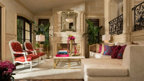 Pitman devised an elegant, European style space that relies on the power of contrast using fabrics in magenta, scarlet and navy against a backdrop of ivory and cream. Photography Credit: Martin King