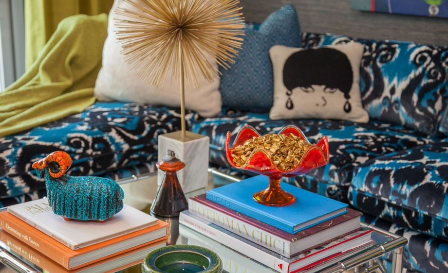 The den features luscious textures and bright colors from the Robert Allen Color Library Calypso Blue collection. Photography Credit: Parker Kennedy