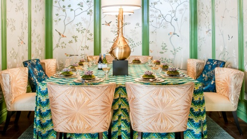 In a vignette designed by Corey Damen Jenkins, hand painted wallpaper panels from de Gournay serve as an opulent backdrop to sumptuous Beacon Hill fabrics.  Photography Credit:  Allan Barry