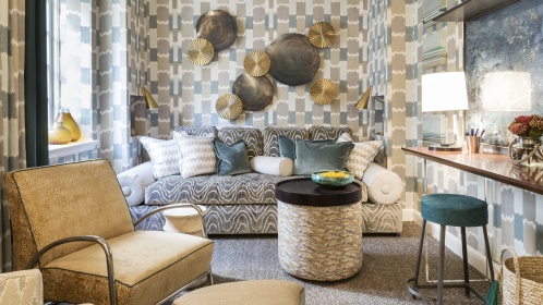 Drew McGukin's upstairs retreat is an elegant mix of patterns from Robert Allen's Landscape Color collection. The walls and draperies create an extraordinary, impressionistic foundation upon which he layered more patterns, original art and found objects.