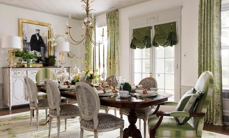 This decadent dining room serves up a visual feast of greens with draperies in Robert Allen's Spring Grass and armchairs in Beacon Hill's Arugula. Photography Credit: AK Interiors