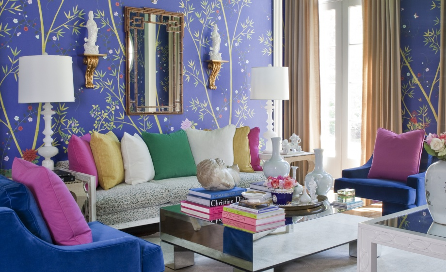 The designers chose clear jewel tones for club chairs (Exquisite in Riviera) and throw pillows (Wool Suit in Fuchsia, Cotton Twill in Garden and Open Plain in Sunray).
